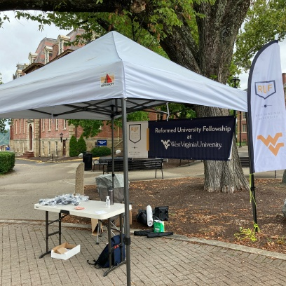 Our new tent, flag, and banner. We tabled for two days before the university went on extended quarantine. I gave away many RUF masks and we got 20 new contacts.